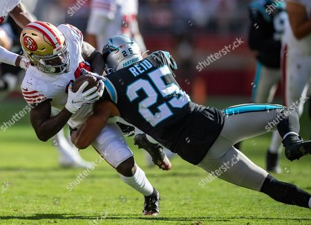 San Francisco 49ers wide receiver Deebo Samuel (19) is tackled by Carolina Panthers safety Eric Reid (25), during a NFL game between the Carolina Panthers and the San Francisco 49ers at the Levi's Stadium in Santa Clara, California