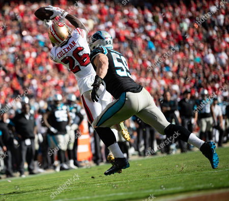San Francisco 49ers running back Tevin Coleman (26) leaps for a catch under pressure from Carolina Panthers middle linebacker Luke Kuechly (59), during a NFL game between the Carolina Panthers and the San Francisco 49ers at the Levi's Stadium in Santa Clara, California