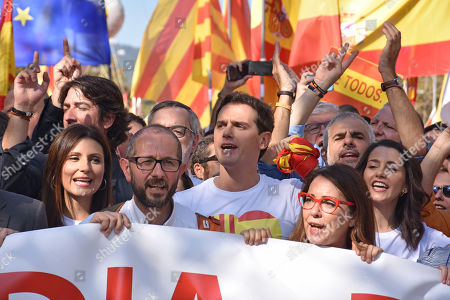 Stock Picture of Lorena Roldan, Albert Rivera, and Ines Arrimadas Garcia of the political party Ciudadanos during the demonstration against Catalan separatists.
