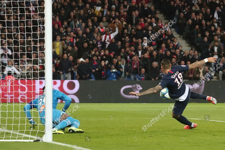 Paris Saint Germain's Mauro Icardi (R) reacts after scoring the 1-0 lead against Marseille's goalkeeper Steve Mandanda (L) during the French Ligue 1 soccer match between PSG and Marseille at the Parc des Princes stadium in Paris, France, 27 October 2019.