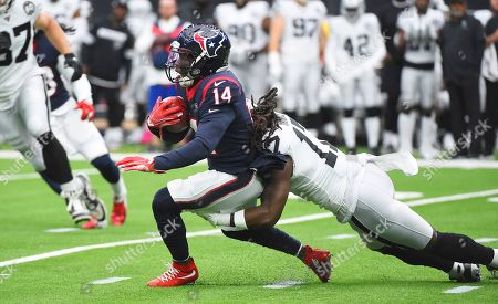 DeAndre Carter, Dwayne Harris. Houston Texans wide receiver DeAndre Carter (14) is hit by Oakland Raiders defender Dwayne Harris (17) after a catch during the first half of an NFL football game, in Houston