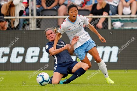 Chicago Red Stars' Y?ki Nagasato (12) becomes entangled with North Carolina Courage's Heather O'Reilly (17) during the first half of an NWSL championship soccer game, in Cary, N.C