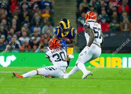 LA Rams Running Back Darrell Henderson (27) is tackled by Cincinnati Bengals Defensive Back Jessie Bates III (30)