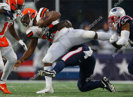 Cleveland Browns running back Nick Chubb (L) is tacked by New England Patriots linebacker Jamie Collins Sr. during the second quarter at Gillette Stadium in Foxborough, Massachusetts, USA, 27 October 2019.