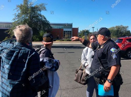 Tim Brown. Napa Valley College Sgt. Hoyt Maddox directs evacuees to a shelter opened there after others closer to the flames filled up or had to be closed as the fast moving fire drew near in Napa Valley, Calif