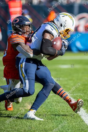 Chicago, Illinois, U.S. - Bears #59 Danny Trevathan tackles Chargers #88 Virgil Green during the NFL Game between the Los Angeles Chargers and Chicago Bears at Soldier Field in Chicago, IL. Photographer: Mike Wulf