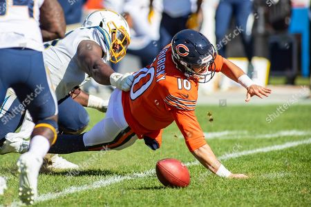 Chicago, Illinois, U.S. - Bears Quarterback #10 Mitchell Trubisky loses the ball as he is sacked by Chargers #71 Damion Square during the NFL Game between the Los Angeles Chargers and Chicago Bears at Soldier Field in Chicago, IL. Photographer: Mike Wulf
