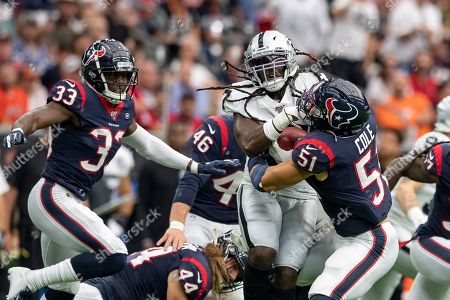 Houston Texans linebacker Dylan Cole (51) tackles Oakland Raiders wide receiver Dwayne Harris (17) during the second quarter at NRG Stadium in Houston, Texas. The score at the half 14-10 Raiders. Maria Lysaker / CSM