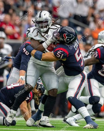 Houston Texans linebacker Dylan Cole (51) tackles Oakland Raiders wide receiver Dwayne Harris (17) during the first quarter at NRG Stadium in Houston, Texas. The score at the half 14-10 Raiders. Maria Lysaker / CSM