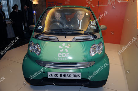 CBI President Helen Alexander and Director General Richard Lambert try out an electric car on display at the Conference