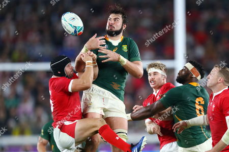 Leigh Halfpenny of Wales and Lood de Jager of South Africa