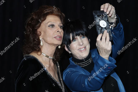 Diane Warren (R) takes a selfie with Italian actress Sophia Loren (L) as they arrive on the red carpet prior to the 11th Annual Governors Awards at the Dolby Theater in Hollywood, California, USA, 27 October 2019.