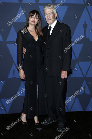 Stock Picture of David Lynch and his wife Emily Stofle pose on the red carpet prior the 11th Annual Governors Awards at the Dolby Theater in Hollywood, California, USA, 27 October 2019.