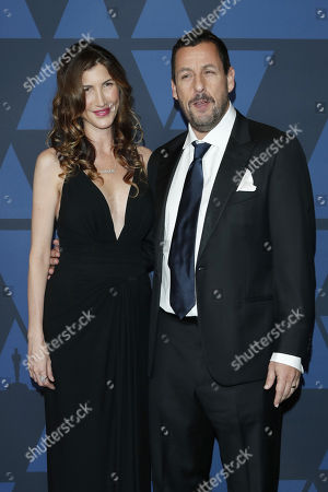 Adam Sandler (R) and wife Jackie Sandler (L) pose on the red carpet prior the 11th Annual Governors Awards at the Dolby Theater in Hollywood, California, USA, 27 October 2019.