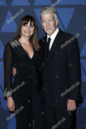 David Lynch and his wife Emily Stofle pose on the red carpet prior the 11th Annual Governors Awards at the Dolby Theater in Hollywood, California, USA, 27 October 2019.