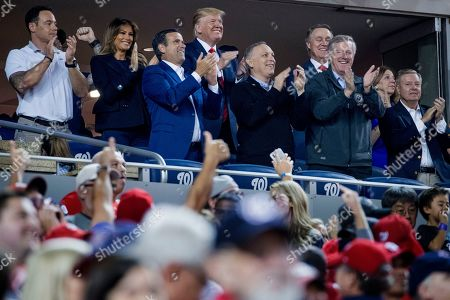 Donald Trump, Melania Trump, John Ratcliffe, Lindsey Graham, Mark Meadows, David Perdue. President Donald Trump, accompanied by first lady Melania Trump, second from left, and Republican lawmakers, stand during a Salute to the Military during Game 5 of a baseball World Series game between the Houston Astros and the Washington Nationals at Nationals Park in Washington, . Also Pictured are Rep. John Ratcliffe, R-Texas, third from left, Sen. Lindsey Graham, R-S.C., right, Sen. David Perdue, R-Ga., fourth from right, and Rep. Mark Meadows, R-N.C., third from right