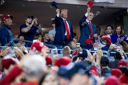 Donald Trump, David Perdue. President Donald Trump, center, accompanied by Sen. David Perdue, R-Ga., right, and a member of the military, left, stands as members of the military are recognized during Game 5 of a baseball World Series between the Houston Astros and the Washington Nationals at Nationals Park in Washington