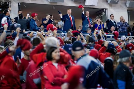 Donald Trump, David Perdue. President Donald Trump, center, accompanied by Sen. David Perdue, R-Ga., right, stands as members of the military are recognized during Game 5 of a baseball World Series between the Houston Astros and the Washington Nationals at Nationals Park in Washington