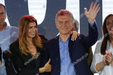 Argentine President and candidate for reelection Mauiricio Macri (R) waves along with his wife Juliana Awada (L) after hearing the results of the presidential election in Buenos Aires, Argentina, 27 October 2019. Macri acknowledged his defeat in the general elections, and said he called his main adversary, Alberto Fernandez, to congratulate him on his victory and invited him to breakfast to begin an 'orderly transition period.' With 90.92 of the votes scrutinized, Macri obtained 40.67 percent of the votes, behind the winner, the Peronist opponent Alberto Fernandez, with 47.82 percent.