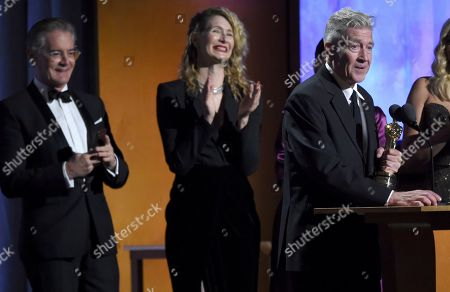 David Lynch, Kyle MacLachlan, Laura Dern. Director David Lynch accepts his honorary award as Kyle MacLachlan, from left, and Laura Dern look on at the Governors Awards, at the Dolby Ballroom in Los Angeles