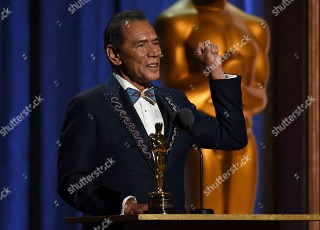 Wes Studi accepts an honorary award at the Governors Awards, at the Dolby Ballroom in Los Angeles
