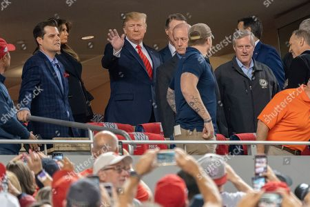 United States President Donald Trump, First lady Melania Trump, Matt Gaetz (Republican of Florida), United States Senator David Perdue (Republican of Georgia) and United States Representative Mark Meadows (Republican of North Carolina)