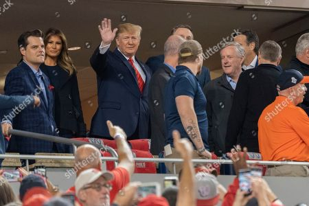 Stock Image of United States President Donald Trump, First lady Melania Trump, Matt Gaetz (Republican of Florida), United States Senator David Perdue (Republican of Georgia), United States Representative Mark Meadows (Republican of North Carolina), and United States Representative Kevin Brady (Republican of Texas)