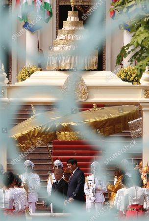 Hungarian President Janos Ader (C-R), inspects a guard of honor with Cambodian King Norodom Sihamoni (C-L), during a welcoming ceremony at the Royal Palace in Phnom Penh, Cambodia, 28 October 2019. President Janos Ader is on an official visit to Cambodia to strengthen ties and cooperation between the two countries.