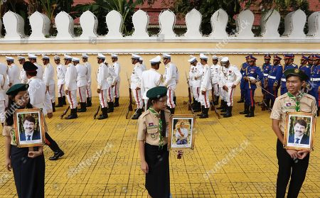 Cambodian students hold portraits of Hungarian President Janos Ader and Cambodian King Norodom Sihamoni, during a welcoming ceremony at the Royal Palace in Phnom Penh, Cambodia, 28 October 2019. President Janos Ader is on an official visit to Cambodia to strengthen ties and cooperation between the two countries.