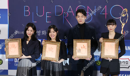 Han Ji-min, Kim Hyang-gi, Nam Joo-hyuk and Kim Da-mi show off their handprints during the 40th Blue Dragon Film Awards in Seoul, South Korea, 28 October 2019. The Blue Dragon Film Awards is an annual awards ceremony for excellence in film in South Korea.