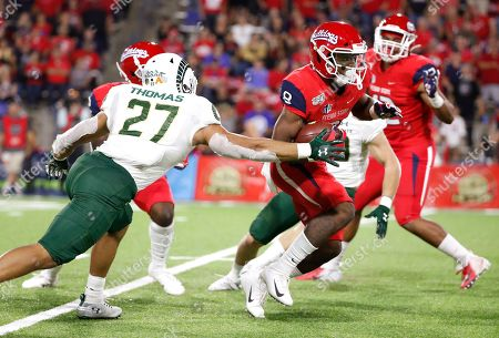 Stock Image of Chris Coleman, Jaylen Thomas. Fresno State Chris Coleman returns a kick against Colorado State's Jaylen Thomas during the second half of an NCAA college football game in Fresno, Calif