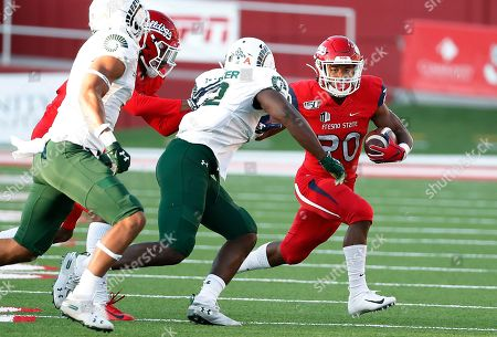 Ronnie Rivers, Cam'ron Carter. Colorado State linebacker Cam'ron Carter, middle, chases Fresno State running back Ronnie Rivers during the first half of an NCAA college football game in Fresno, Calif