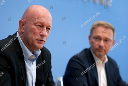 Thomas L. Kemmerich, left, FDP top candidate, and Christian Lindner, right, chairman of the German Free Democratic Party (FDP), addresses the media during a press conference in Berlin, Germany, one day after the state elections in the German state of Thuringia