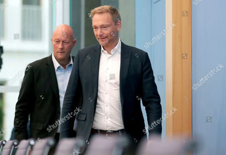Thomas L. Kemmerich, left, FDP top candidate, and Christian Lindner, right, chairman of the German Free Democratic Party (FDP), arrive for a press conference in Berlin, Germany, one day after the state elections in the German state of Thuringia