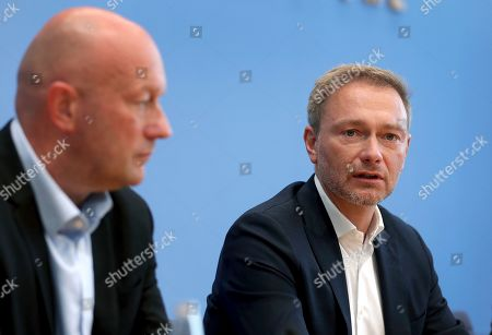 Thomas L. Kemmerich, left, FDP top candidate, and Christian Lindner, right, chairman of the German Free Democratic Party (FDP), address the media during a press conference in Berlin, Germany, one day after the state elections in the German state of Thuringia