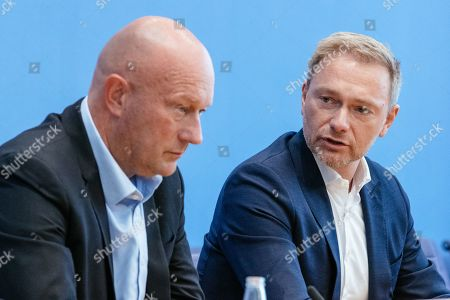 Chairman of German Free Democratic (FDP) party Christian Lindner (R) and Thuringia top co-candidate of the FDP Thomas Kemmerich (L) attend a press conference on the result of the Thuringia state elections in Berlin, Germany, 28 October 2019. The FDP party finished sixth in Thuringia state elections with 5 percent of the total votes, gaining 2.5 percent more than the last time.