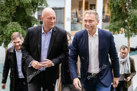 Stock Image of Chairman of German Free Democratic (FDP) party Christian Lindner (R) and Thuringia top co-candidate of the FDP Thomas Kemmerich (L) attend a press conference on the result of the Thuringia state elections in Berlin, Germany, 28 October 2019. The FDP party finished sixth in Thuringia state elections with 5 percent of the total votes, gaining 2.5 percent more than the last time.