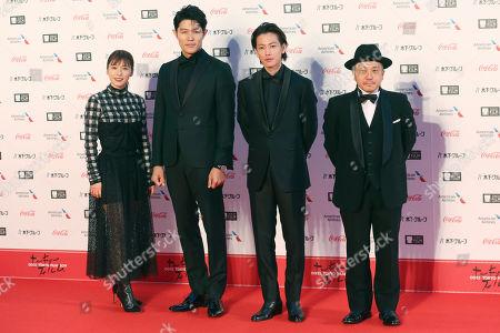 From left; Japanese actress Mayu Matsuoka, actor Ryohei Suzuki actor Takeru Sato and director Kazuya Shiraishi pose for photographers during the opening ceremony of the Tokyo International Film Festival in Tokyo
