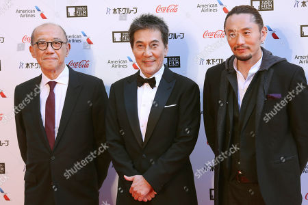 From left, Hong Kong-American producer Terence Chang Japanese actor Koji Yakusho and director Fay Yu pose for photographers during the opening ceremony of the Tokyo International Film Festival in Tokyo