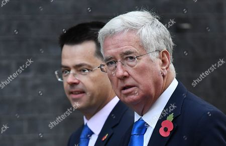 Former British Defence Scretary Michael Fallon (R) with former Secretary of State for Housing James Brokenshire (L) as they arrive at 10 Downing Street in London, Britain, 28 October 2019.