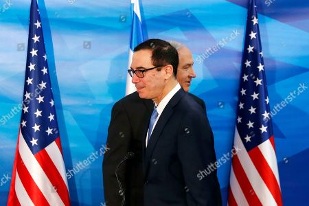 Israeli Prime Minister Benjamin Netanyahu walks behind US Treasury Secretary Steven Mnuchin as they prepare to deliver joint statements during their meeting in Jerusalem, 28 October 2019.