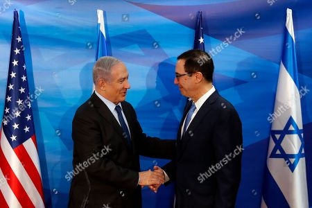 Israeli Prime Minister Benjamin Netanyahu and US Treasury Secretary Steven Mnuchin shake hands as they deliver joint statements during their meeting in Jerusalem, 28 October 2019.