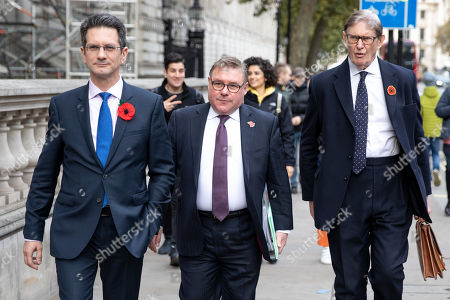 Chairman of the European Research Group (ERG) Steve Baker MP (L) walks with Mark Francois MP and Bill Cash MP (R) through Westminster.