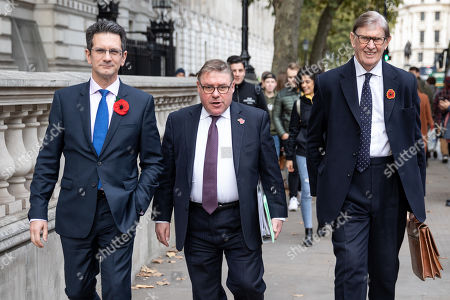 Stock Image of Chairman of the European Research Group (ERG) Steve Baker MP (L) walks with Mark Francois MP and Bill Cash MP (R) through Westminster.