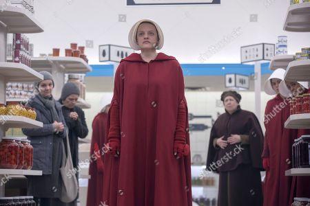 Elisabeth Moss as June Osborne and Ann Dowd as Aunt Lydia Clements, Nina Kiri as Alma and Bahia Watson as Brianna