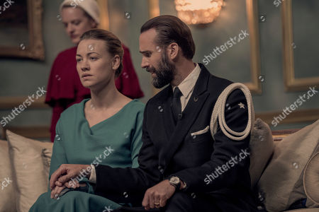 Elisabeth Moss as June Osborne, Yvonne Strahovski as Serena Joy Waterford and Joseph Fiennes as Fred Waterford