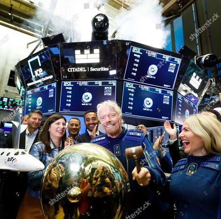 Sir Richard Branson (C), the founder of Virgin Galactic, rings a ceremonial bell at the New York Stock Exchange to celebrate the first day of trading of Virgin Galactic Holdings shares in New York, New York, USA, on 28 October 2019. The commercial space travel and exploration company is a result of the merger of Virgin Galactic and Social Capital Hedosophia.