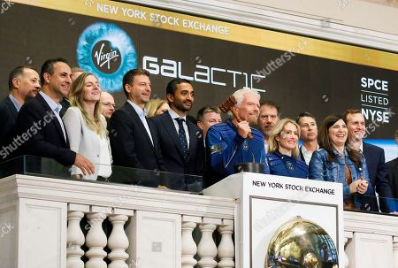 Sir Richard Branson (6-R), the founder of Virgin Galactic, and Chamath Palihapitiya (6-L), the founder of Social Capital Hedosophia, and other company representatives pose for a picture at the New York Stock Exchange to celebrate the first day of trading of Virgin Galactic Holdings shares in New York, New York, USA, on 28 October 2019. The commercial space travel and exploration company is a result of the merger of Virgin Galactic and Social Capital Hedosophia.