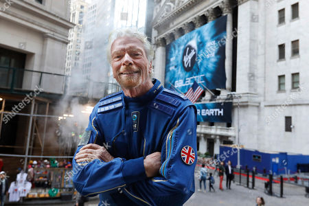 Sir Richard Branson, founder of Virgin Galactic, poses for a photo outside the New York Stock Exchange before his company's IPO