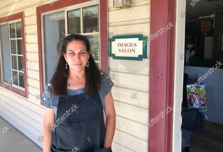 """Beauty salon owner Susan Slates stands outside her salon in Agua Dulce, Calif., a lightly populated expanse of grassy hills and horse ranchettes north of Los Angeles and the hometown of U.S. Rep. Katie Hill, D-Calif. Hill has apologized to friends and supporters for engaging in an inappropriate affair with a campaign staffer, but she still let down Slates. Slates, a Democrat, said she was """"disappointed,"""" but quickly jumped to Hill's defense, saying anything she did pales in comparison to what's she's witnessed under President Donald Trump"""